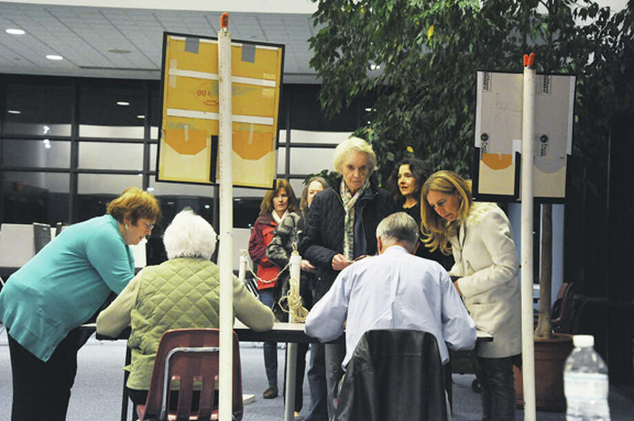 Wilton residents line up for a vote Tuesday at a special town meeting at the Clune Center in Wilton to discuss the preservation of a 39-acre open space property on Cannon Road.