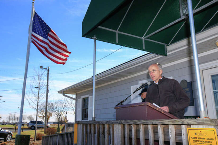 Hour Photo / Chris Palermo. Geoffrey Steadman, Norwalk Harbor Commission Planning Consultant, speaks at the press conference held at Veteran's Park to announce the third phase of the norwalk harbor dredging project is nearing completion. / © 2013 Hour Newspapers All Rights Reserved