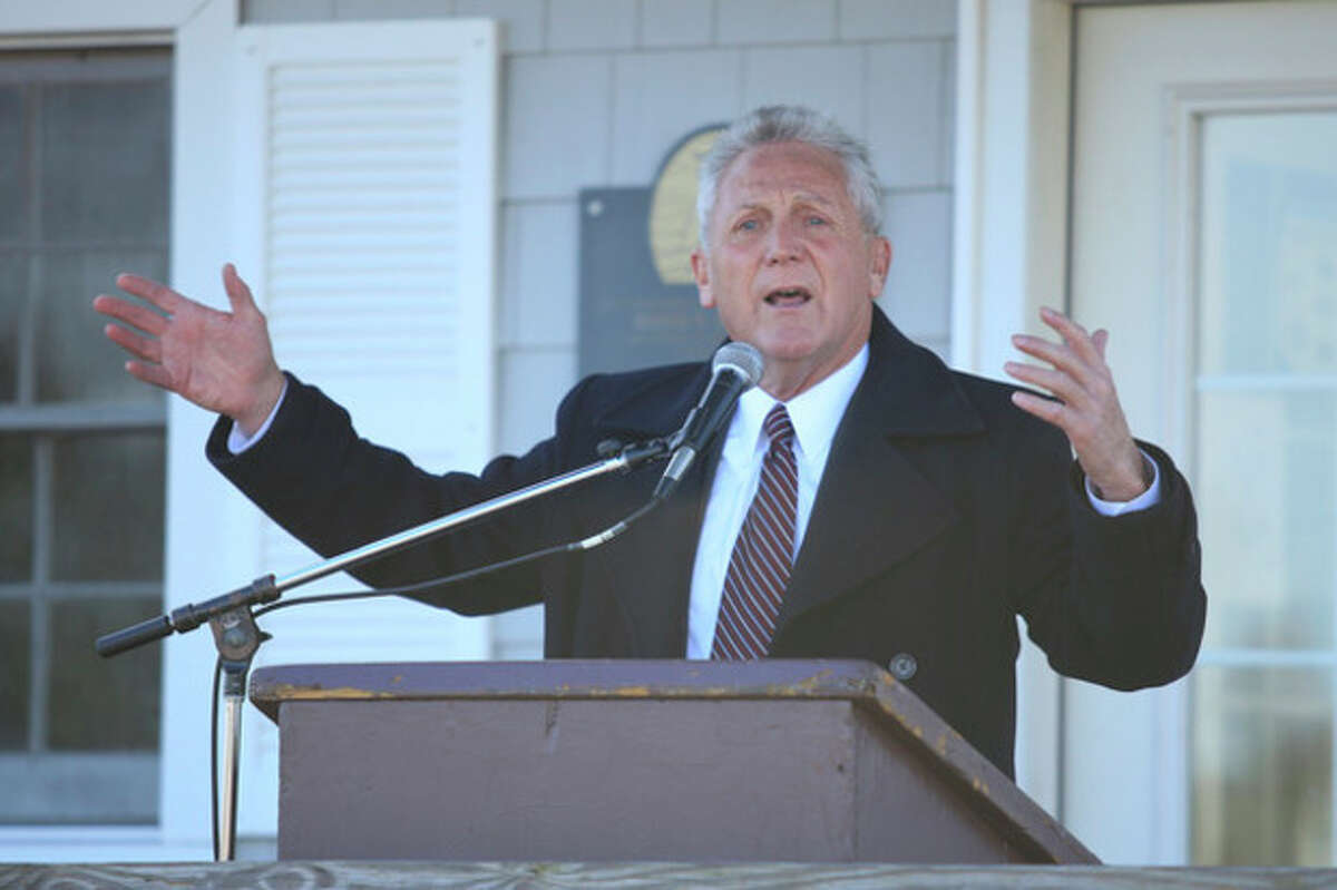 Hour Photo / Chris Palermo. Norwalk Mayor Harry Rilling speaks at a press conference Wednesday at Veteran's Park announcing third phase of the Norwalk Harbor Dredging Project is nearing completion.