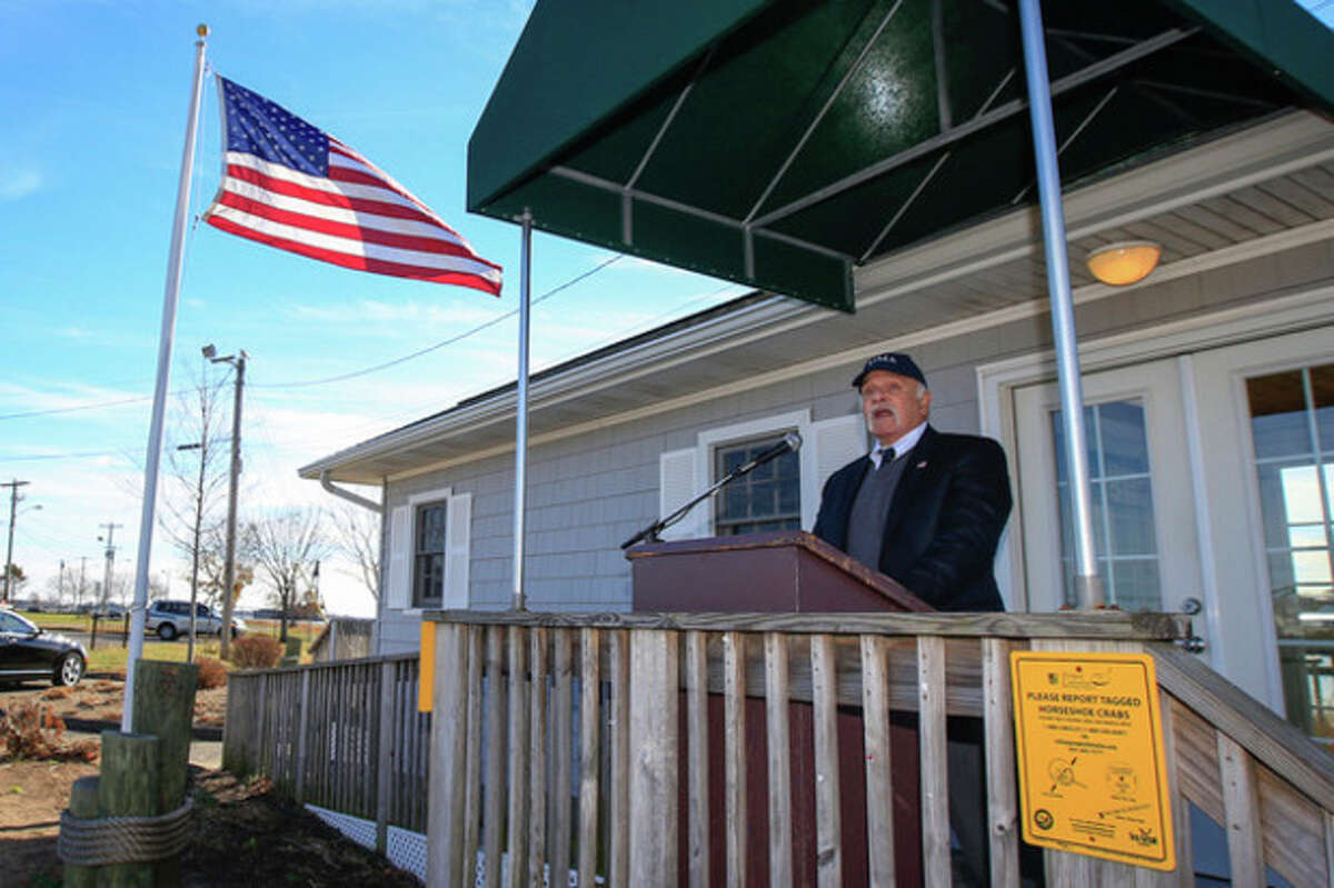 Hour Photo / Chris Palermo. John T. Pinto, chairman of the Norwalk Harbor Management Commision's Dredging Committee speaks at a press conference Wednesday at Veteran's Park announcing third phase of the Norwalk Harbor Dredging Project is nearing completion.