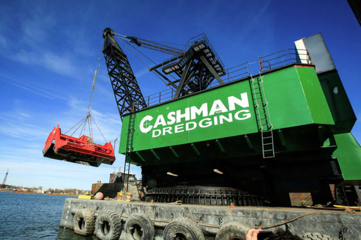"""Hour Photo / Chris Palermo. The Cashman """"Dale Pyatt"""" Dredge sits on the Norwalk Harbor Wednesday afternoon. The clamshell bucket shown here is capable of holding up to 70 cubic yards of waste at a time."""