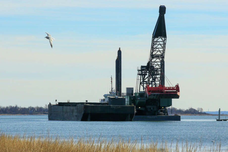 Hour Photo / Chris Palermo. The Cashman Dredge sits on the Norwalk Harbor Wednesday afternoon. / © 2013 Hour Newspapers All Rights Reserved
