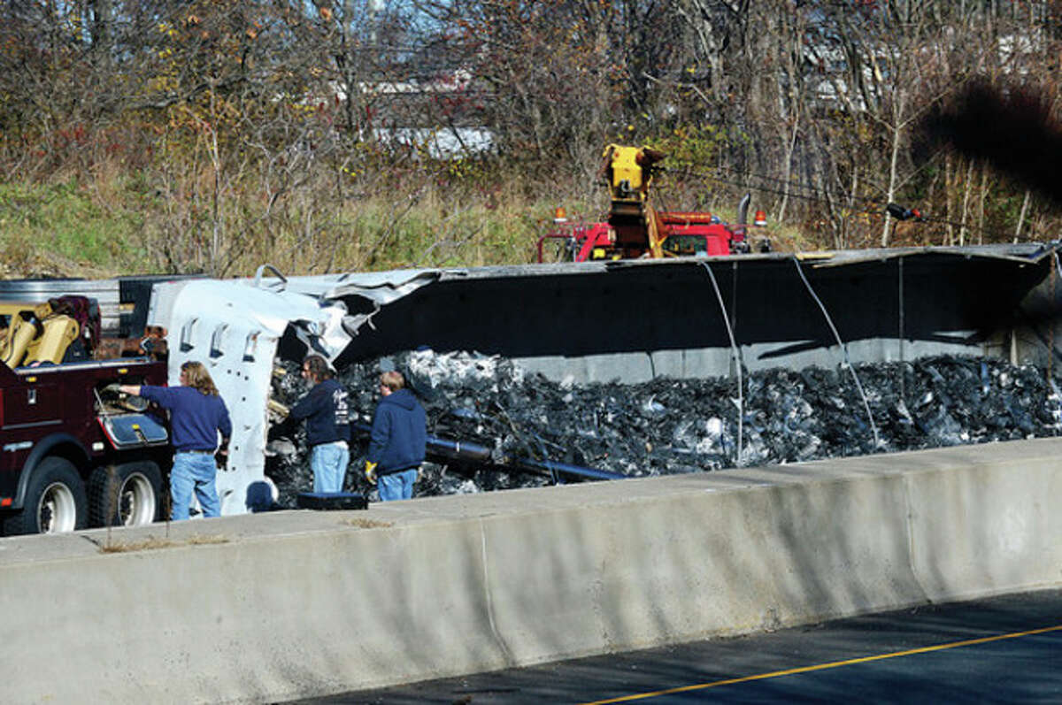 Hour photo / Erik Trautmann The rollover took six hours to clean up and shut down traffic completely between 10 a.m. and 2 p.m., Wednesday afternoon.