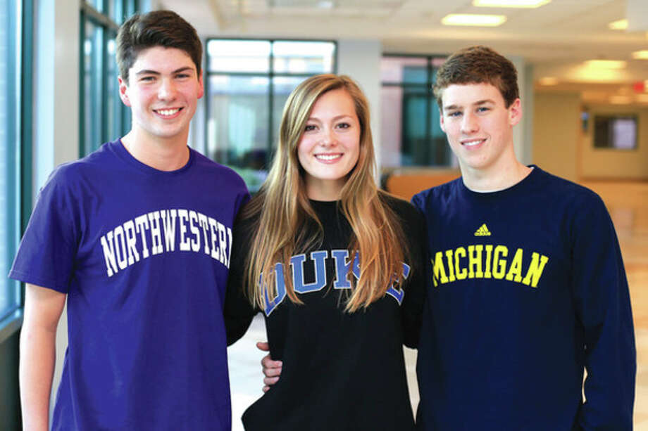 Hour photo/Chris PalermoJonathan Blansfield (Northwestern), Verity Abel (Duke) and Ian Rainey (Michigan) pose for a portrait after Friday's session in which they announced the college choices and signed their National Letter of Intent. / © 2013 Hour Newspapers All Rights Reserved
