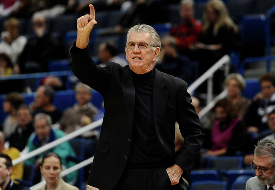 Oregon head coach Paul Westhead gestures to his team during the first half of an NCAA college basketball game against Connecticut, Wednesday, Nov. 20, 2013, in Hartford, Conn. (AP Photo/Jessica Hill) / FR125654 AP