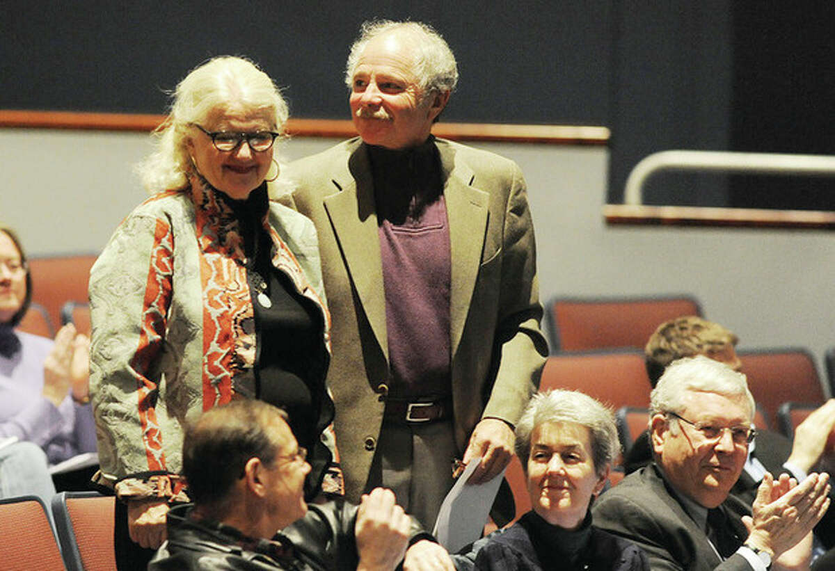 Hour photo / Matthew Vinci Property owners Peter and Florence Keiser are acknowledged at a special town meeting at the Clune Center in Wilton to discuss the preservation of a 39-acre open space property on Cannon Road.