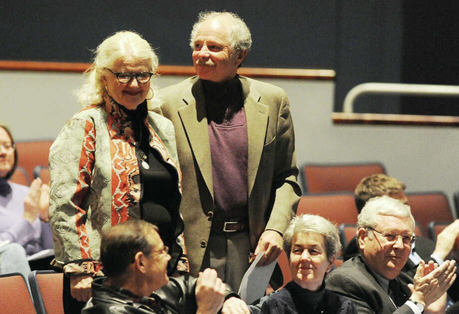 Hour photo / Matthew VinciProperty owners Peter and Florence Keiser areacknowledged at a special town meeting at the Clune Center in Wilton to discuss the preservation of a 39-acre open space property on Cannon Road.