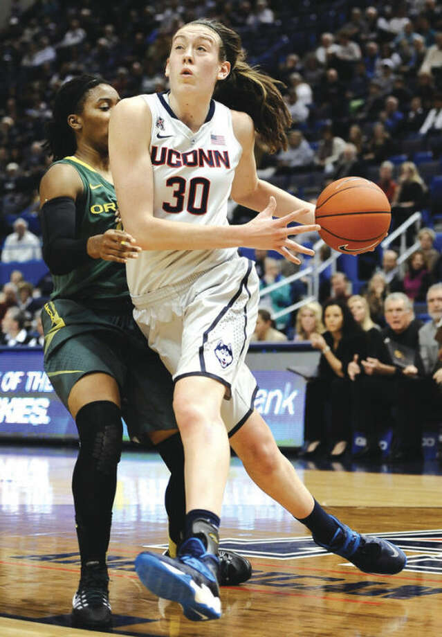 AP photoUConn's Breanna Stewart, right, drives past Oregon's Chrishae Rowe during Wednesday night'sgame at the XL Center. Stewart had a game-high 28 points for the top-ranked Huskies in their 114-68 victory over the Ducks.