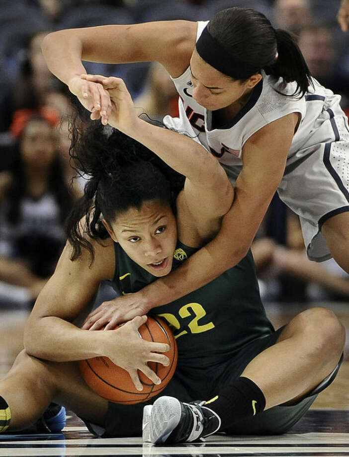 Connecticut's Bria Hartley, top, pressures Oregon's Ariel Thomas, bottom, during the first half of an NCAA college basketball game, Wednesday, Nov. 20, 2013, in Hartford, Conn. (AP Photo/Jessica Hill)