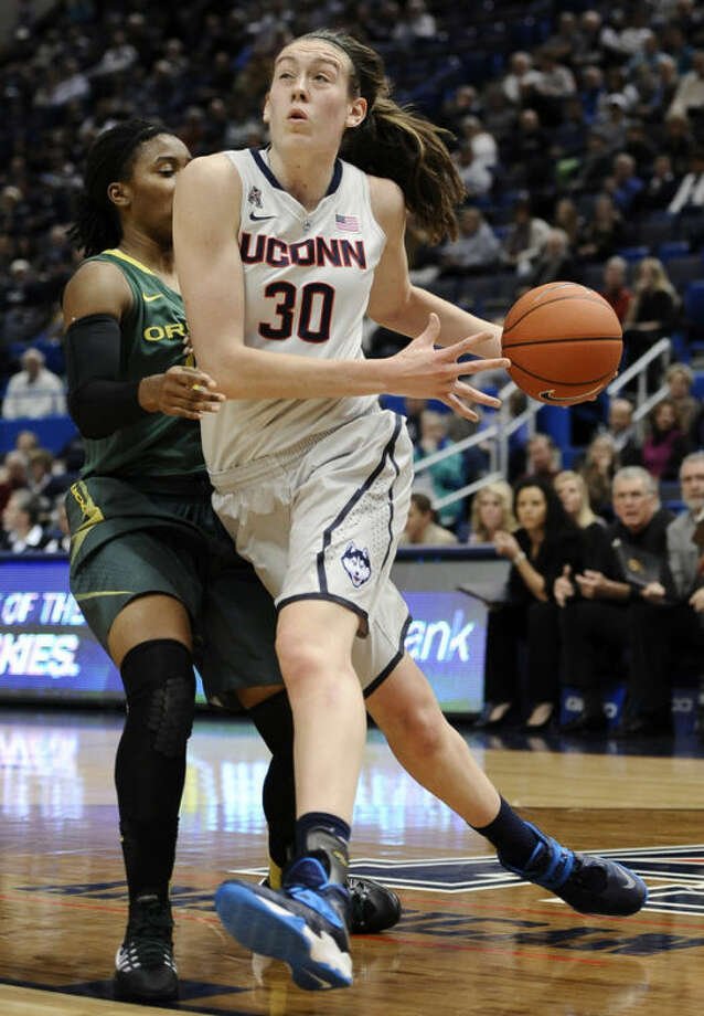Connecticut's Breanna Stewart, right, drives past Oregon's Chrishae Rowe, left, during the first half of an NCAA college basketball game, Wednesday, Nov. 20, 2013, in Hartford, Conn. (AP Photo/Jessica Hill)