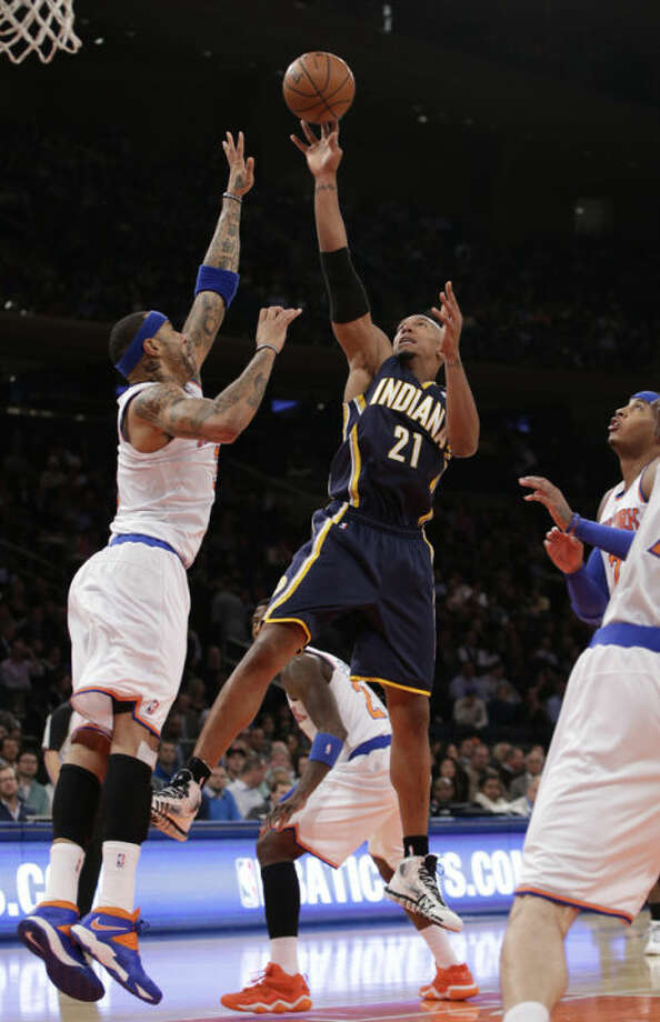 Indiana Pacers forward David West (21) takes a shot with New York Knicks forward Kenyon Martin (3) defending in the first half of their NBA basketball game at Madison Square Garden in New York, Wednesday, Nov. 20, 2013. (AP Photo/Kathy Willens)