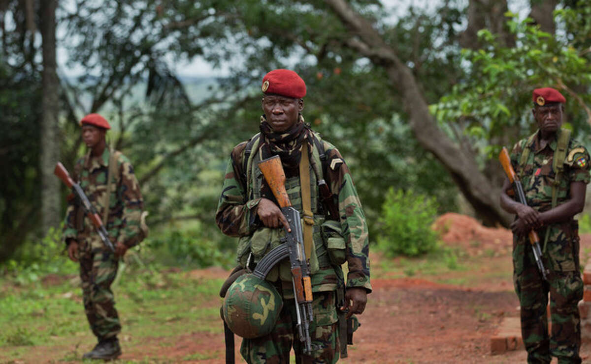 FILE - In this Sunday, April 29, 2012 file photo, troops from the Central African Republic stand guard at a building used for joint meetings between them and U.S. Army special forces, in Obo, Central African Republic, where U.S. special forces have paired up with local troops and Ugandan soldiers to seek out Joseph Kony's Lord's Resistance Army (LRA). The spokesman for Uganda's military said Thursday, Nov. 21, 2013 that he's pessimistic that reported contact with rebel leader and accused war criminal Joseph Kony will bear fruit. (AP Photo/Ben Curtis, File)