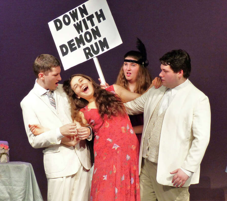 Contributed photoSomeone spikes the lemonade at the town picnic! From the left, Sean Fredriksen, Krystina Lyons from Norwalk, Abby DeMarkey from Stamford and Max Helfand from Norwalk practice this hilarious scene from Crystal Theatre's upcoming production of Prohibition, Norwalk: 1925!