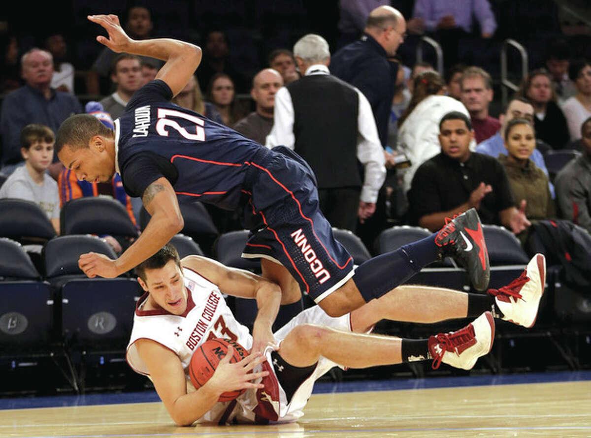 AP photo Boston College's Alex Dragicevich, bottom, and UConn's Omar Calhoun battle for the ball during Thursday night's game.