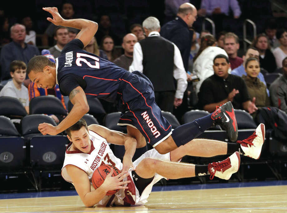 AP photoBoston College's Alex Dragicevich, bottom, and UConn's Omar Calhoun battle for the ball during Thursday night's game. / AP