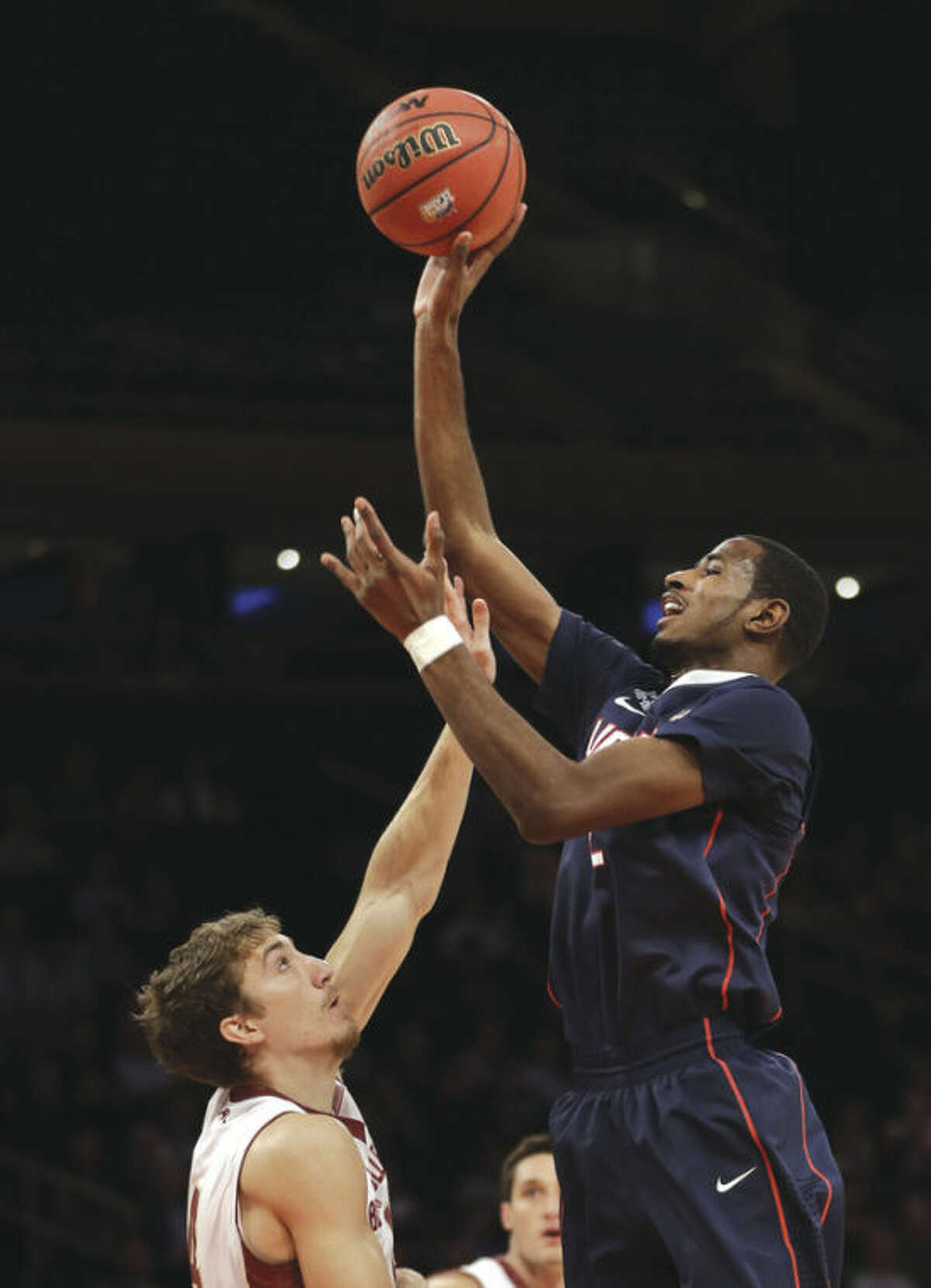 AP photo UConn's DeAndre Daniels, right, shoots over Boston College's Eddie Odio during the first half of Thursday night's game at Madison Square Garden. Daniels had a team-high 23 points in the Huskies' 72-70 victory.