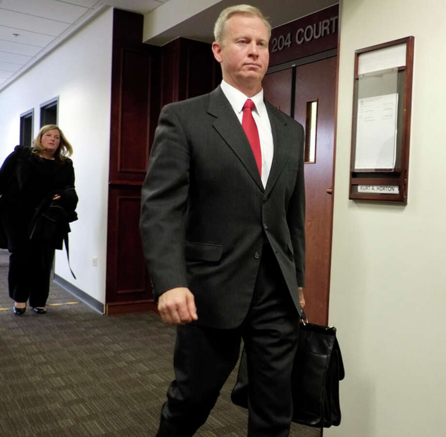 District Attorney George Brauchler leaves district court in Centennial, Colo., on Thursday, Nov. 21, 2013, after a hearing in the James Holmes case. Brauchler requested a second mental evaluation of Holmes. As a result district judge Carlos A. Samour Jr. postponed the start of the trial scheduled for February. Holmes is charged with killing 12 people and wounding more than 50 in a crowded Colorado movie theater last year.(AP Photo/Ed Andrieski) / AP