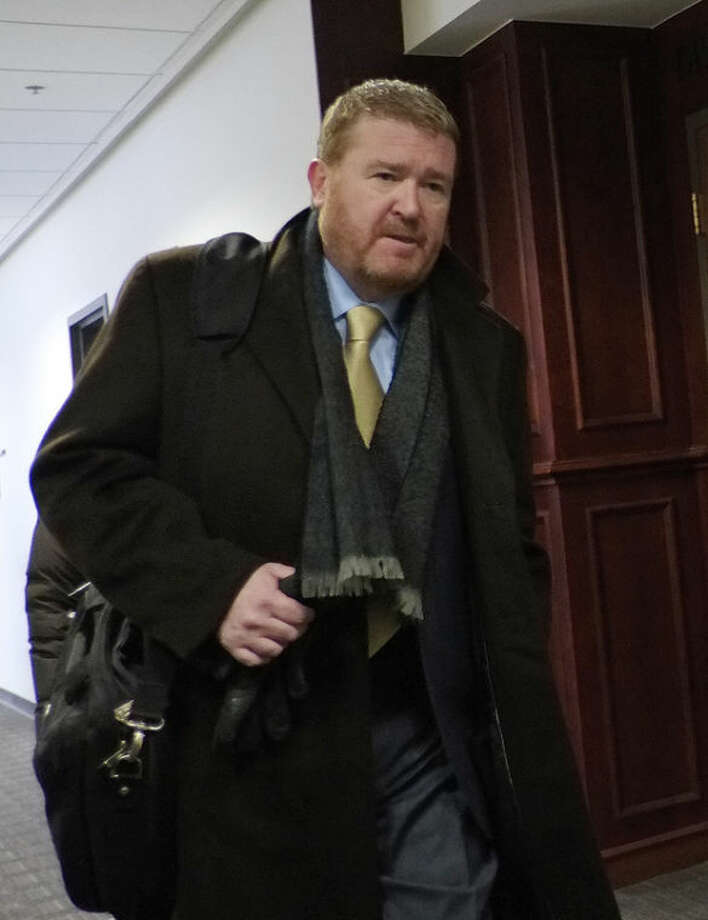 Daniel King, defense attorney for James Holmes, leaves district court in Centennial, Colo., on Thursday, Nov. 21, 2013, where the prosecutor in the case, District Attorney George Brauchler, asked for a second mental evaluation of Holmes. District Judge Carlos A. Samour Jr. delayed the start of the trial. Holmes is charged with killing 12 people and wounding more than 50 in a crowded Colorado movie theater last year. (AP Photo/Ed Andrieski)