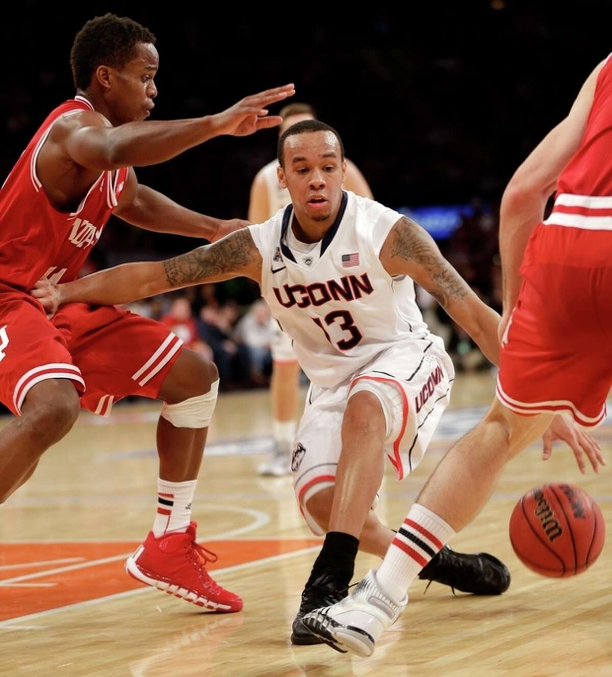 Connecticut's Shabazz Napier dribbles through traffic during the first half of an NCAA college basketball game against Indiana, Friday, Nov. 22, 2013, in New York. (AP Photo/Seth Wenig)