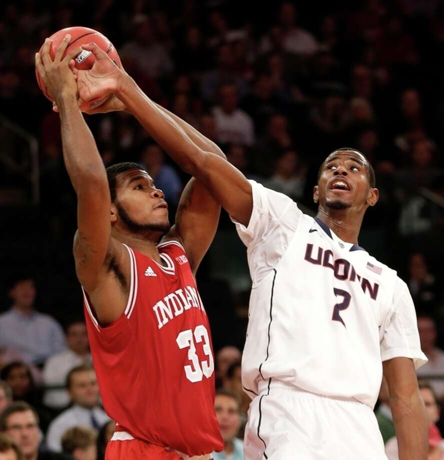 Indiana's Jeremy Hollowell, left, fights for a rebound with Connecticut's DeAndre Daniels during the first half of an NCAA college basketball game on Friday, Nov. 22, 2013, in New York. (AP Photo/Seth Wenig) / AP