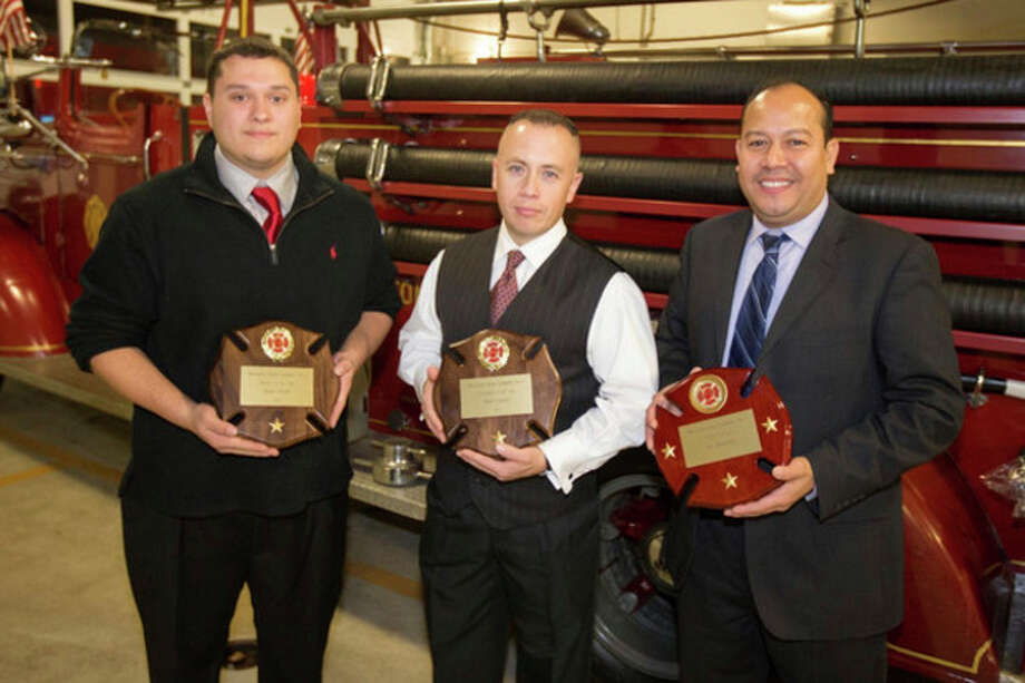 Hour photo / Chris Palermo. Three award recipients were among the principals attending the 113th annual dinner of the Rowayton Hose Company No. 1. From left, Firefighter James Smith, Rookie-of the Year; Firefighter Matt Lucero, Firefighter-of -the-Year,and Lt. Jay Sequeira, Chief's Award. / © 2013 Hour Newspapers All Rights Reserved