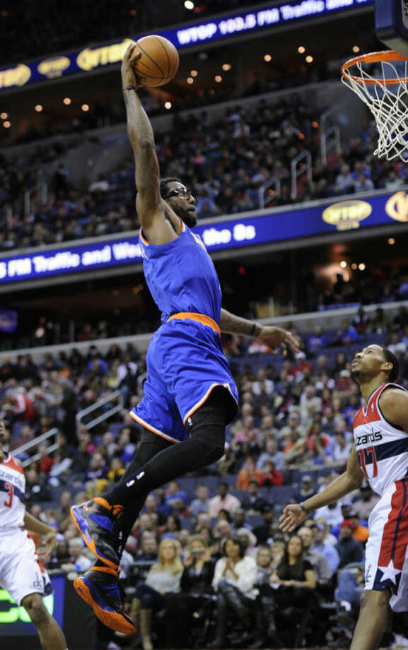 New York Knicks forward Amare Stoudemire, left, goes to the basket against Washington Wizards guard Garrett Temple (17) during the first half of an NBA basketball game on Saturday, Nov. 23, 2013, in Washington. (AP Photo/Nick Wass)
