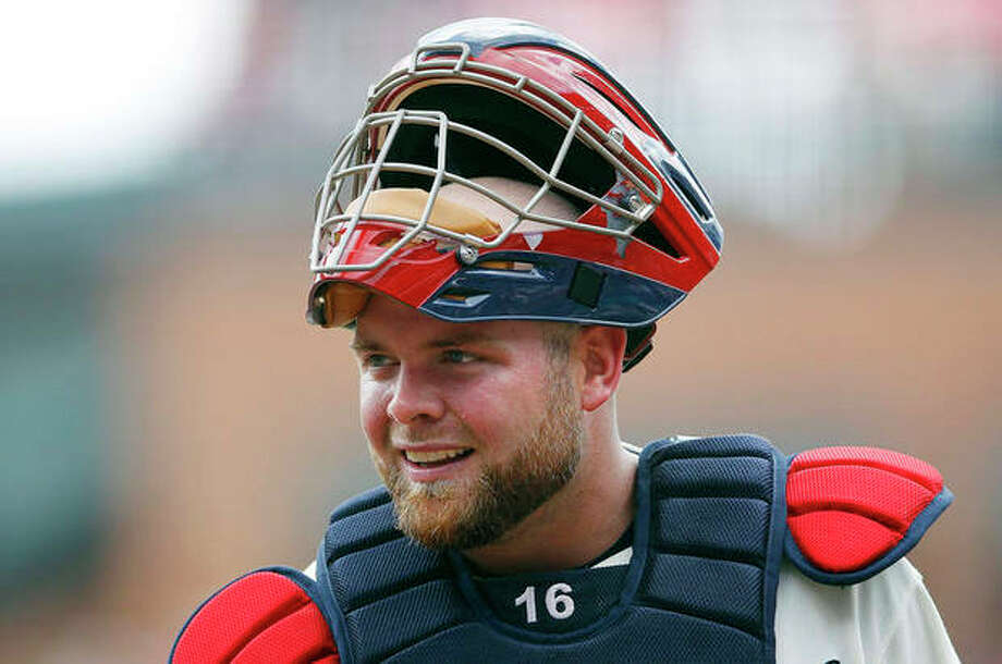 FILE - In this July 15, 2012, file photo, Atlanta Braves catcher Brian McCann looks on during a baseball game against the New York Mets in Atlanta. A person familiar with the negotiations tells The Associated Press that free-agent McCann and the New York Yankees are about to close a five-year deal for about $85 million. The person spoke Saturday night, Nov. 23, 2013, on condition of anonymity because the deal was not complete. (AP Photo/John Bazemore, File) / AP