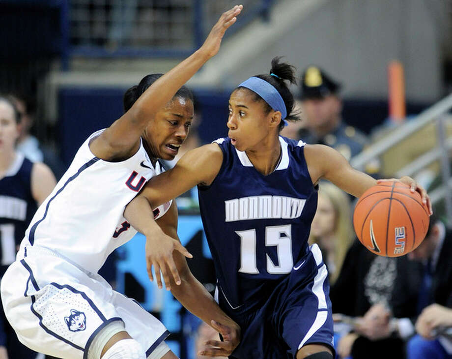 Connecticut's Brianna Banks (13) guards Monmouth's Jasmine Walker during the first half of an NCAA college basketball game, in Storrs, Conn., on Saturday, Nov. 23, 2013. (AP Photo/Fred Beckham) / FR153656 AP