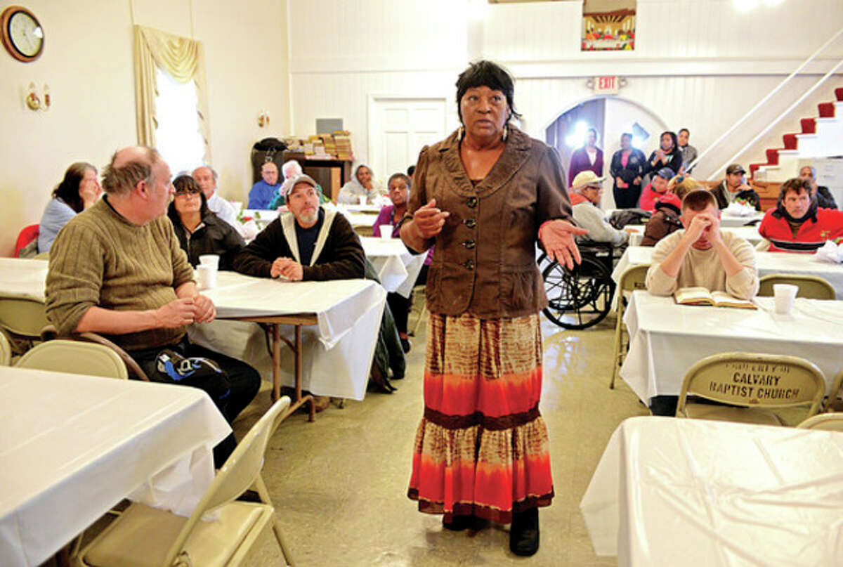 Hour photo / Erik Trautmann The Rev. Nellie Mann hosts her annual pre-Thanksgiving feast for the needy at Calvary Baptist Church Saturday.