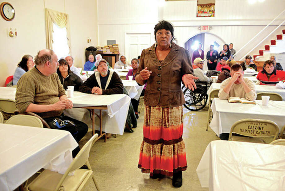 Hour photo / Erik Trautmann The Rev. Nellie Mann hosts her annual pre-Thanksgiving feast for the needy at Calvary Baptist Church Saturday. / (C)2013, The Hour Newspapers, all rights reserved
