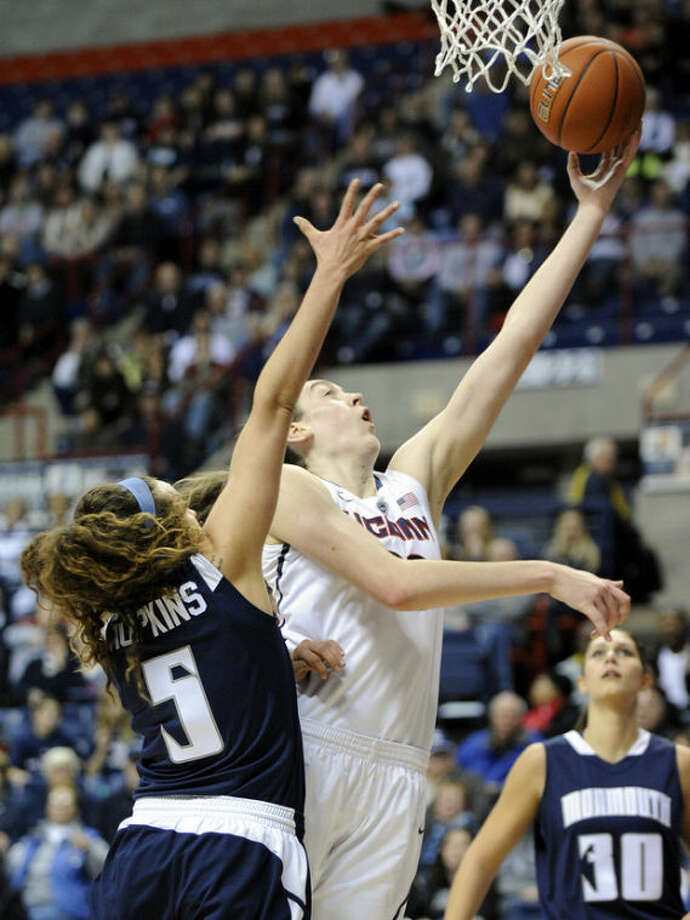 Connecticut's Breanna Stewart (30) drives past Monmouth's Mia Hopkins during the first half of an NCAA college basketball game, in Storrs, Conn., on Saturday, Nov. 23, 2013. (AP Photo/Fred Beckham)