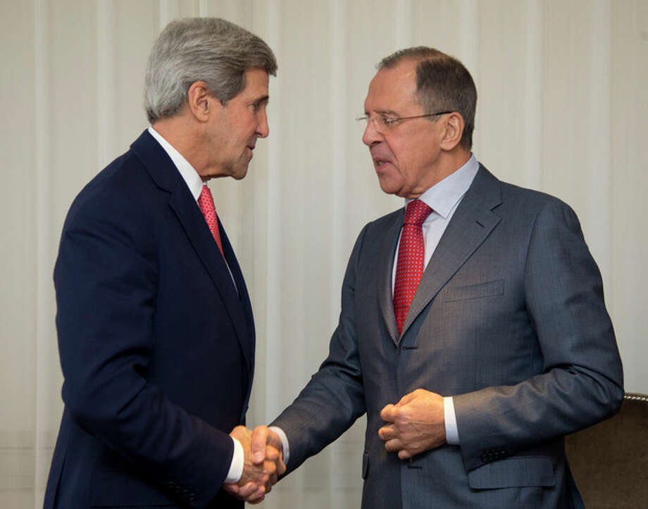 U.S. Secretary of State John Kerry, left and Russia's Foreign Minister Sergei Lavrov shake hands, during a photo opportunity, prior to their meeting, in Geneva, Switzerland, Saturday, Nov. 23, 2013. U.S. Secretary of State John Kerry and foreign ministers of other major powers joined Iran nuclear talks on Saturday, throwing their weight behind a diplomatic push to complete a deal after envoys reported progress on key issues blocking an interim agreement to curb the Iranian program in return for limited sanctions relief. (AP Photo/Carolyn Kaster, Pool) / Pool AP