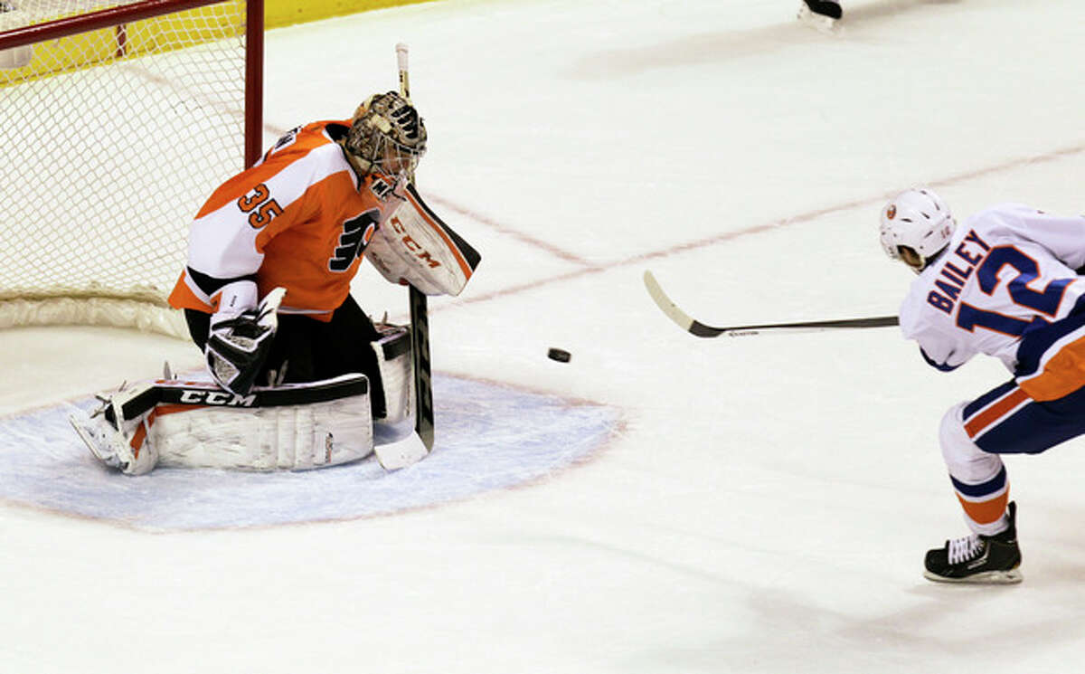 Philadelphia Flyers' goalie Steve Mason stops a shot on goal by New York Islanders' Josh Bailey in the final minute of the first period of an NHL hockey game, Saturday, Nov. 23, 2013, in Philadelphia. (AP Photo/Laurence Kesterson)