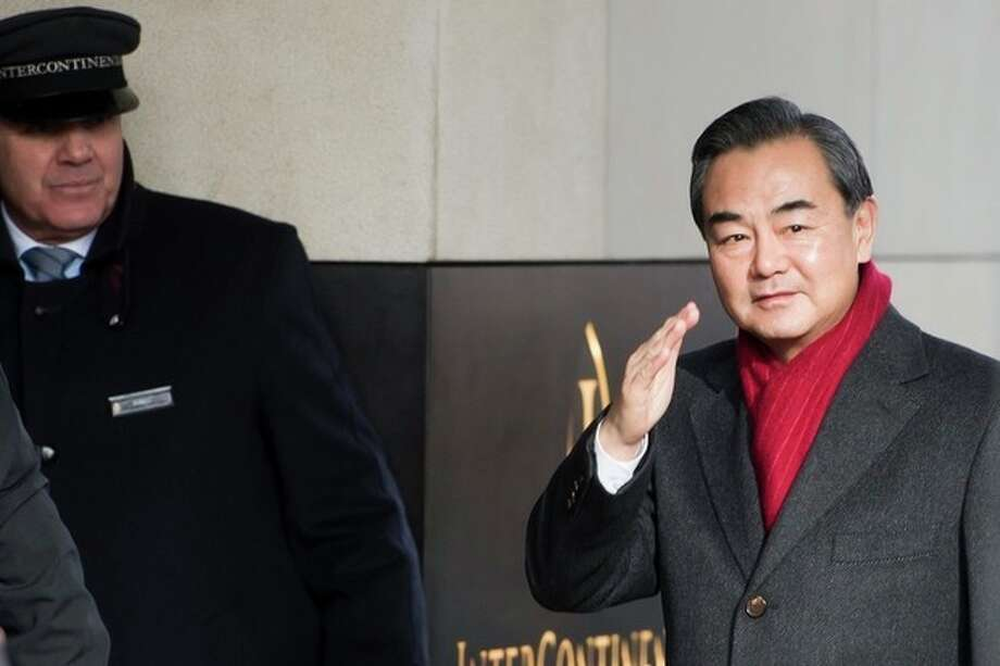 Chinese Foreign Minister Wang Yi, arrives at the Intercontinental Hotel prior to talks on Iran's nuclear program in Geneva, Switzerland, Saturday, Nov. 23, 2013. U.S. Secretary of State John Kerry and five foreign ministers joined Iran nuclear talks Saturday, cautioning there were no guarantees their participation would be enough to seal a deal to curb Tehran's atomic program. The goal is a six-month agreement to freeze Iran's nuclear program while offering Iran incentives through limited sanctions relief. If the interim deal holds, the parties would negotiate final stage deals to ensure Iran does not build nuclear weapons. (AP Photo/Keystone,Jean-Christophe Bott) / KEYSTONE