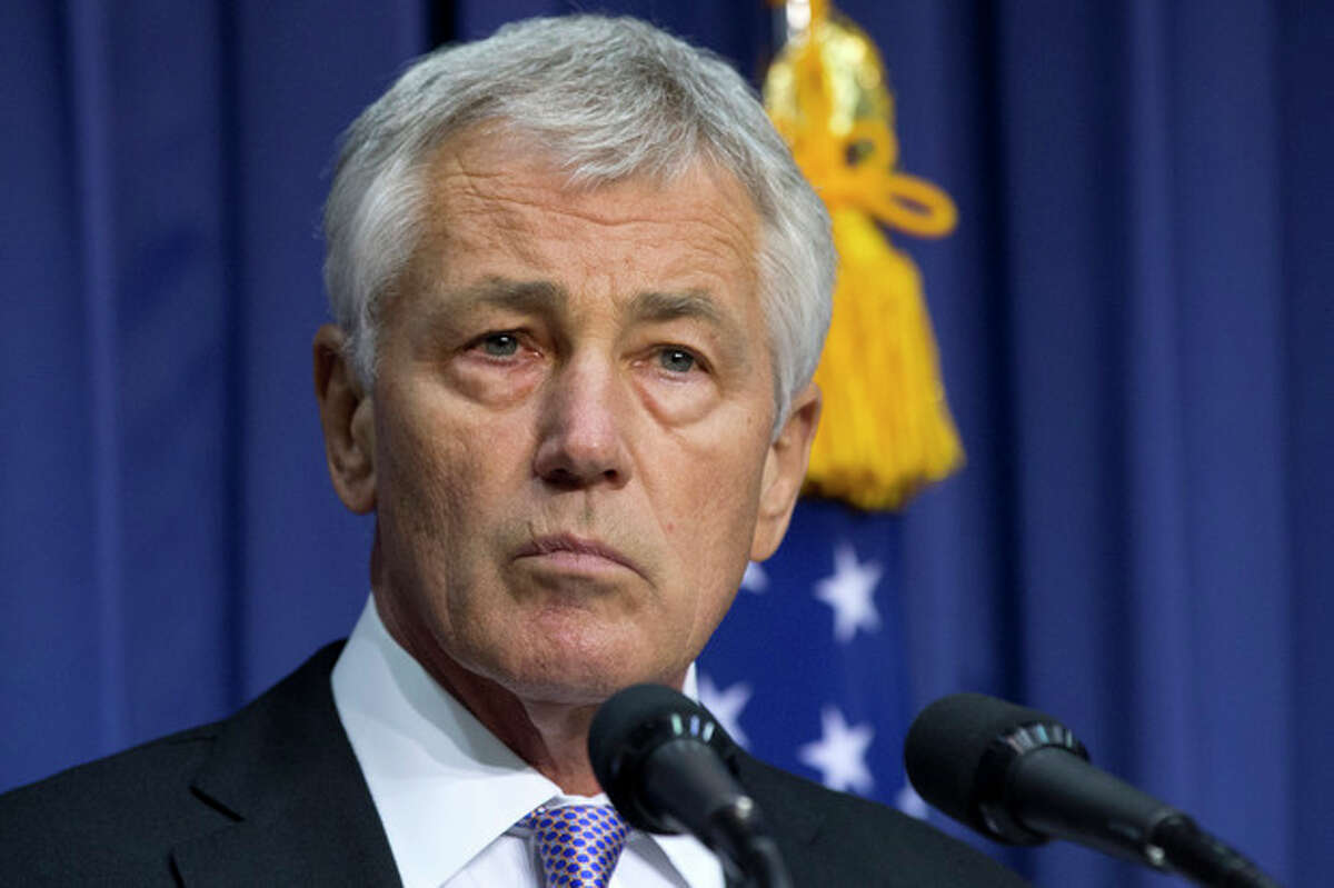 FILE - In this Oct. 2, 2013, file photo, Secretary of Defense Chuck Hagel appears at news conference at the Ministry of National Defense in Seoul, South Korea. The U.S. military is looking for ways to expand operations in the vast waters of the Arctic as melting ice caps open sea lanes, and other nations such as Russia compete for the lucrative oil and gas deposits. Hagel says climate, energy and security issues revolving around the Arctic will continue to grow in importance. (AP Photo/Jacquelyn Martin, Pool, File)