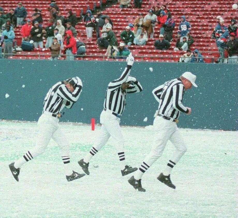 FILE - In this Dec. 23, 1995 file photo, three referees get hit with snowballs from New York Giants fans upset over a loss to the San Diego Chargers, in East Rutherford, N.J. The 197-year-old Farmers' Almanac is already out with its forecast that a big winter storm will hit the area around 2014 Super Bowl weekend in East Rutherford. (AP Photo/Newsday, J.Conrad Williams, File) NYC LOCALS OUT NO SALES / NEWSDAY