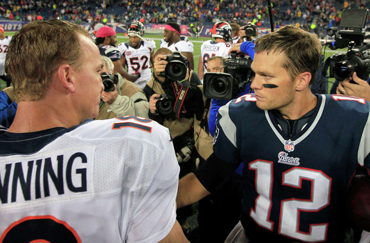 FILE - In this Oct. 7, 2012, file photo, Denver Broncos quarterback Peyton Manning, left, and New England Patriots quarterback Tom Brady, right, speak in the middle of the field after the Patriots beat the Broncos 31-21 in an NFL football game in Foxborough, Mass. Manning and Brady will square off for the 14th time Sunday, Nov. 24, 2013, when the Broncos travel to New England. (AP Photo/Steven Senne, File)
