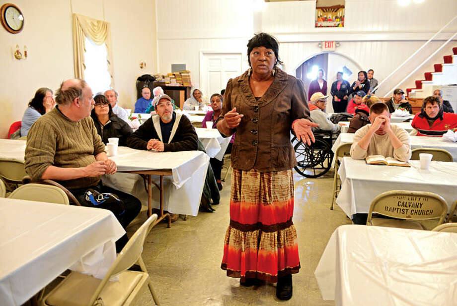 Hour photo / Erik Trautmann The Rev. Nellie Mann hosts her annual pre-Thanksgiving feast for the needy at Calvary Baptist Church Saturday.