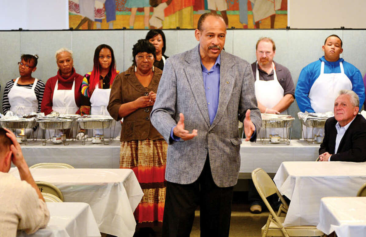 Hour photo / Erik Trautmann The Rev. Dr. Jeffrey A. Ingraham addresses the volunteers and guests during Rev. Nellie Mann's annual pre-Thanksgiving feast for the needy at Calvary Baptist Church Saturday.