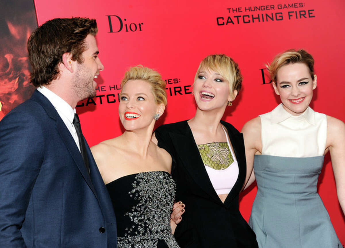 From left, actors Liam Hemsworth, Elizabeth Banks, Jennifer Lawrence and Jena Malone, attend a special screening of