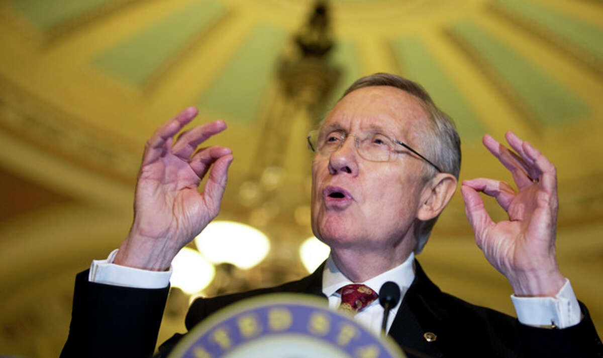 Senate Majority Leader Sen. Harry Reid, D-Nev., speaks to the media on Capitol Hill in Washington, Tuesday, Nov. 19, 2013. The Senate is nearing a potential showdown on curbing the power that the Republican minority has to block President Barack Obama?'s nominations, as Democrats edge toward muscling a rewrite of filibuster rules through the chamber. Reid was expected to force a vote as soon as Thursday on requiring only 51 votes to end filibusters, or delaying tactics, against nominees for high-level judgeships and agency officials. (AP Photo/Manuel Balce Ceneta)