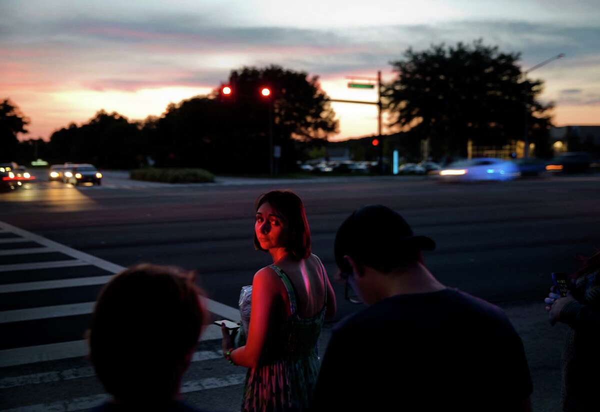 A mourner waits to cross the street while leaving a visitation for Pulse nightclub shooting victim Javier Jorge-Reyes Wednesday, June 15, 2016, in Orlando, Fla.