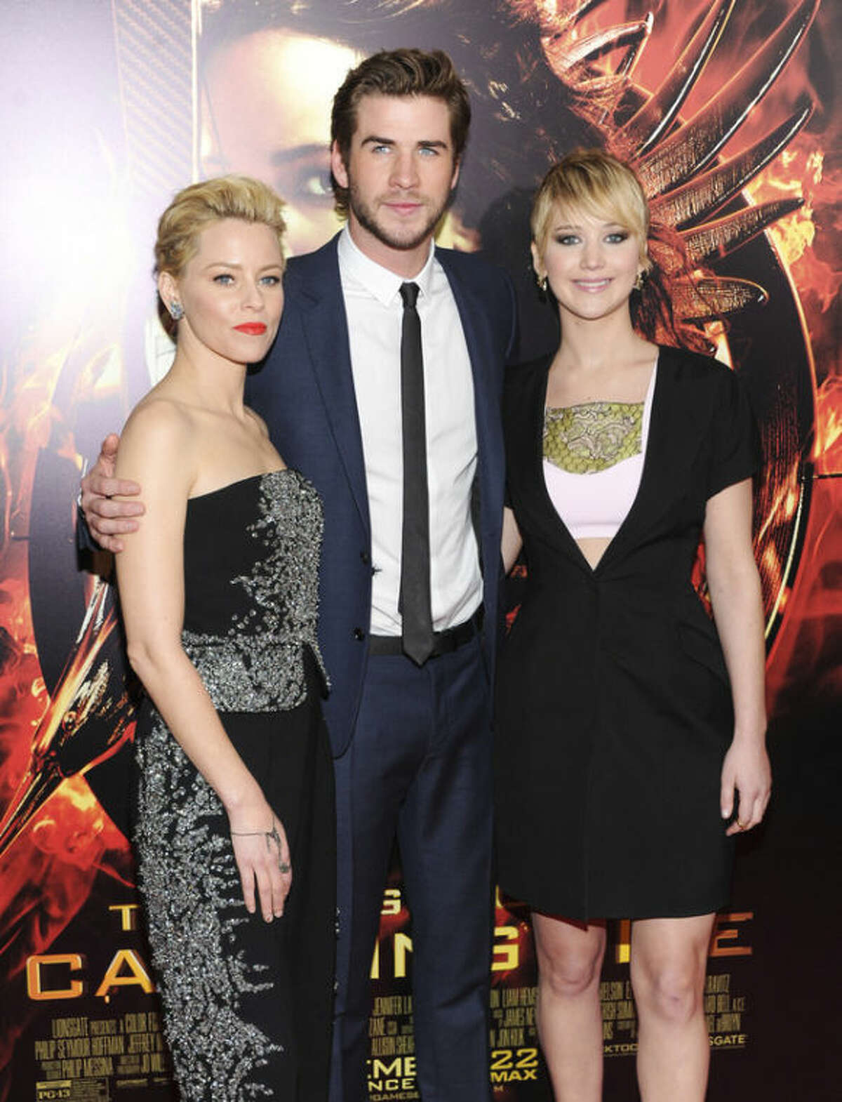 From left, actors Elizabeth Banks, Liam Hemsworth and Jennifer Lawrence attend a special screening of
