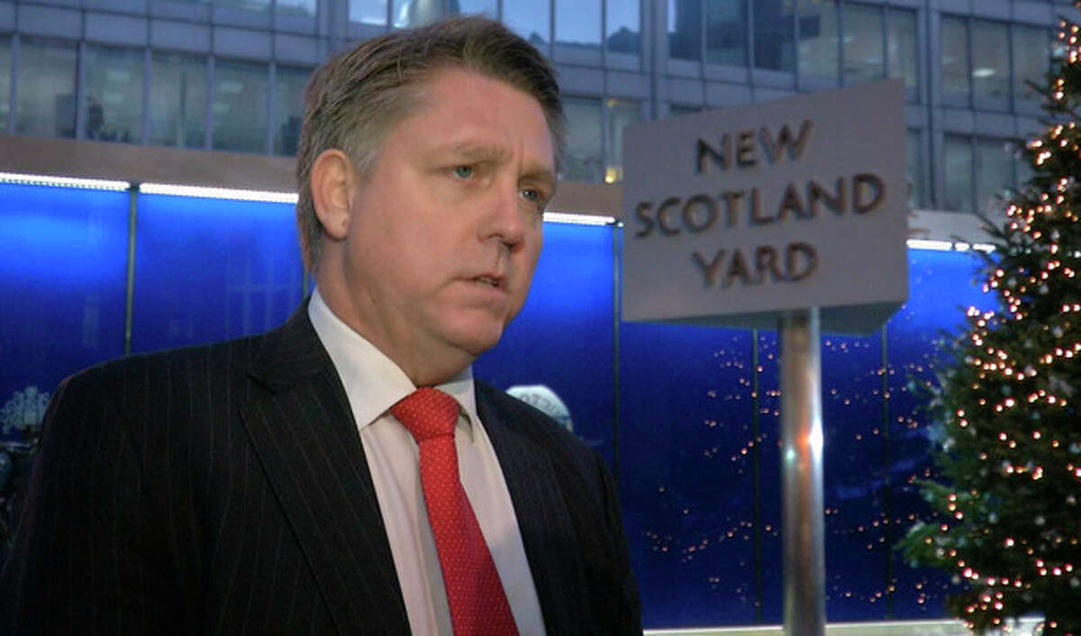 Kevin Hyland, head of the Metropolitan Police's human trafficking unit speaks to the media outside New Scotland Yard's headquarters in this image taken from TV Thursday Nov. 21, 2013. London police say three women were held for at least 30 years against their will in a south London home. Metropolitan Police revealed Thursday the women had been rescued and announced the arrests of two people as part of an investigation into slavery and domestic servitude. (AP Photo/ Sky TV, via Associated Press Television) UNITED KINGDOM OUT TV OUT