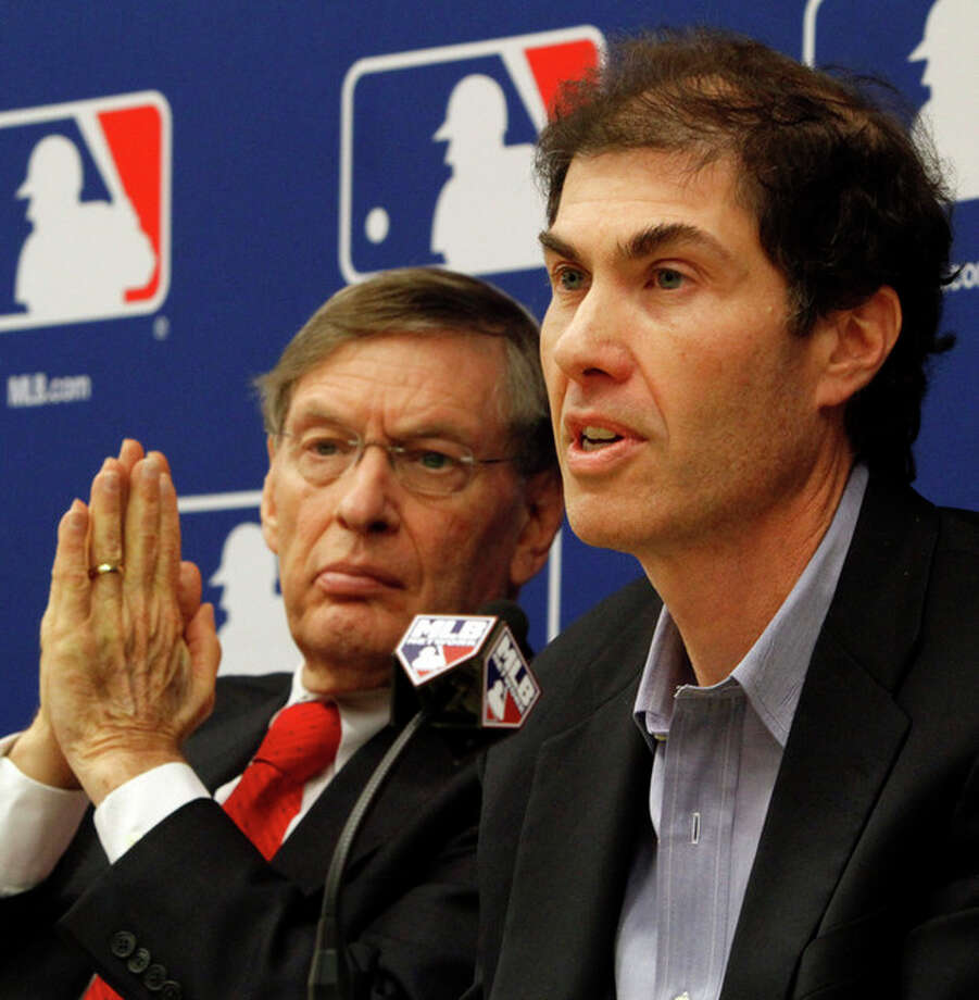 FILE - In this Nov. 22, 2011, file photo, Major League Baseball Commissioner Bud Selig, left, and MLB Players Association Executive Director Michael Weiner hold a news conference announcing a five-year collective bargaining agreement in New York. Weiner, the plain-speaking, ever-positive labor lawyer who took over as head of the powerful baseball players' union four years ago and smoothed the group's perennially contentious relationship with management, died Thursday, Nov. 21, 2013, 15 months after announcing he had been diagnosed with an inoperable brain tumor. He was 51. (AP Photo/Bebeto Matthews, File) / AP