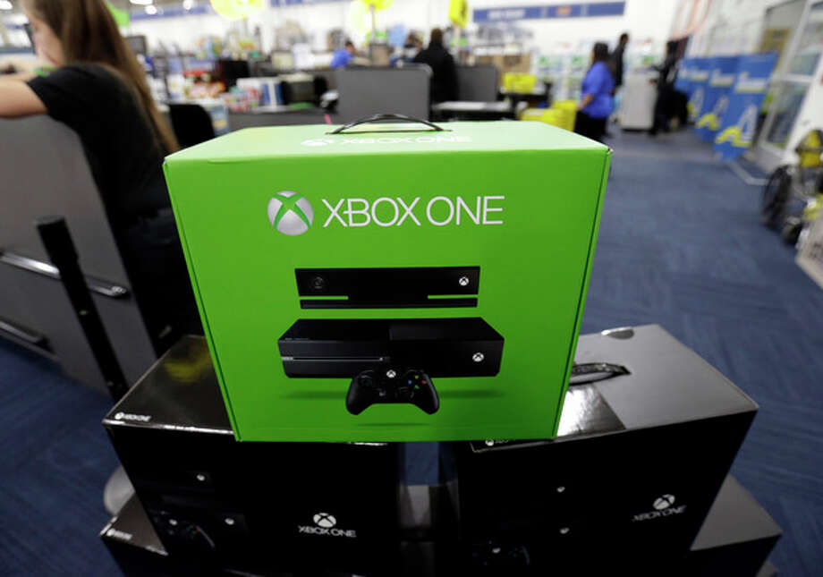 Xbox One display at a Best Buy store on Friday, Nov. 22, 2013., in Evanston, Ill. The Xbox One, which includes an updated Kinect motion sensor, cost $500. Microsoft is billing it as an all-in-one entertainment system rather than just a gaming console. (AP Photo/Nam Y. Huh) / AP