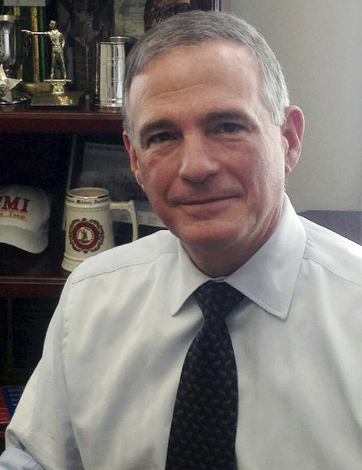 In this Nov. 20, 2013 photo, Steve Sanetti, president and CEO of the National Shooting Sports Foundation, poses in his office in Newtown, Conn. In an exclusive interview with The Associated Press, Sanetti said the gun industry's national trade association and lobbying organization considered moving its offices from Newtown after last year's shooting rampage at Sandy Hook Elementary School. He said he polled workers and none of them wanted to move, saying they are part of the community. (AP Photo/Susan Haigh)