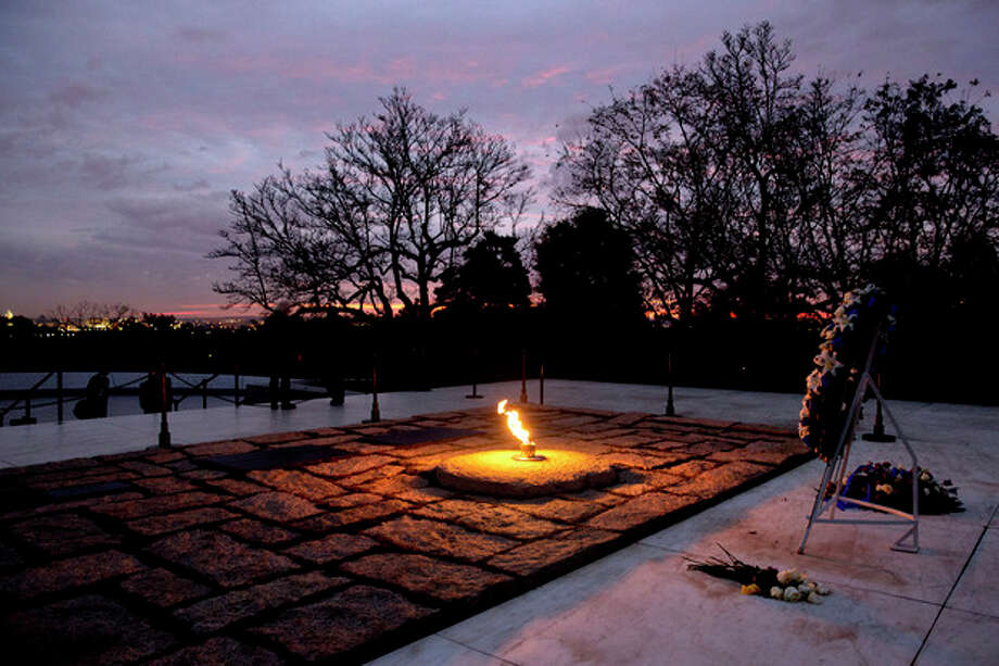 The eternal flame flickers in the early morning light at the grave of John F. Kennedy at Arlington National Cemetery on Friday, Nov. 22, 2013, on the 50th anniversary of Kennedy's death. (AP Photo/Jacquelyn Martin) / AP