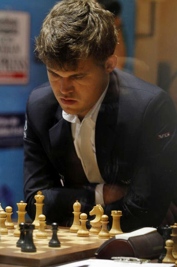 Norway's Magnus Carlsen plays against reigning world chess champion India's Viswanathan Anand during the Chess World Championship match in Chennai, India, Friday, Nov. 22, 2013. (AP Photo/Arun Sankar K.)
