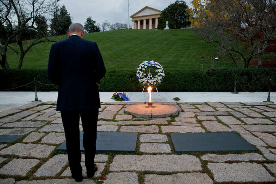Attorney General Eric Holder pays his respects at the grave of John F. Kennedy at Arlington National Cemetery on Friday, Nov. 22, 2013, on the 50th anniversary of Kennedy's death. Holder has been visiting the grave since his youth. (AP Photo/Jacquelyn Martin) / AP
